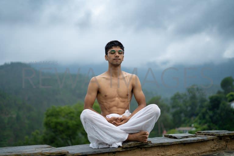Man practicing meditation and zen energy yoga