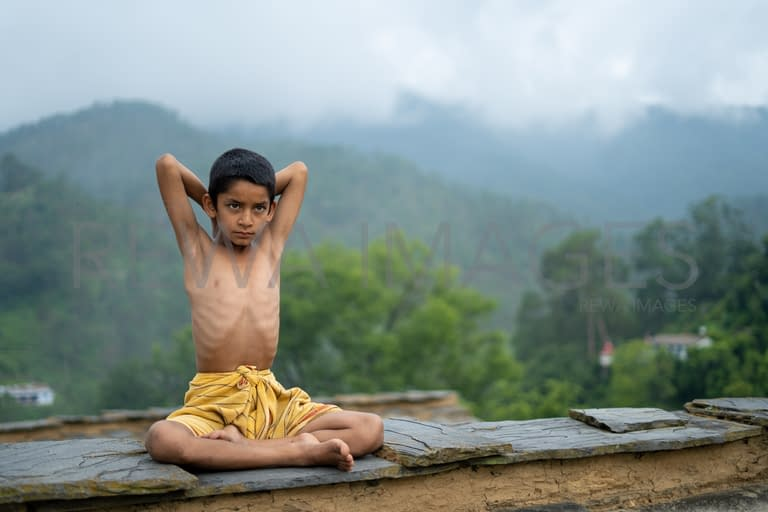 Kid doing yoga