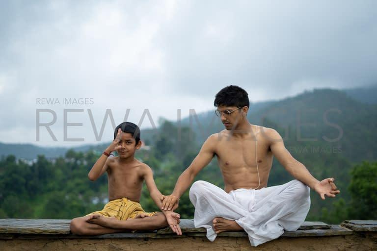 A teenage boy and a kid